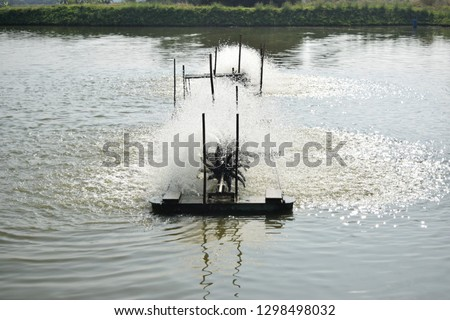 this pic show the paddle wheels aerator activity at the pond culture, targets for increase Oxygen in water, Aquaculture concept