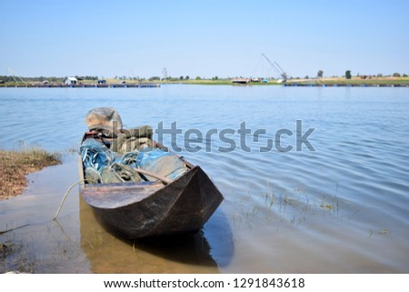 this pic show the small fishing boats made by wood, it floating on the river, take photo from Thailand, lifestyle of local people concept