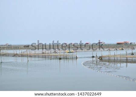 this pic show village in seafarm have many pen culture for rearing econmic fish, crabs or aquatic animal in China  there are a community of fishery and aquafarming.