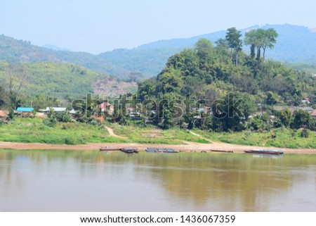 this pic shows a village located Mekong riverside have boats and fish cage culture in port areas