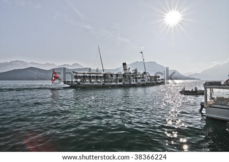 this picture is made at the Vierwaldstättersee, Switzerland. I have alienated it into the picture style of 1920. This ship is a paddlesteamer travelling to Luzern.