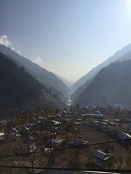 This picture was clicked in Neelum Valley, Azad Jammu and Kashmir, Pakistan. The picture contains beautiful scene of sunrise along with beautiful view of mountains, hills, flowing river and greenery.