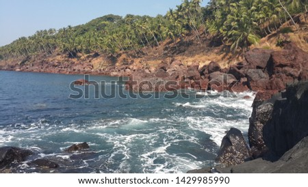 This picture was taken at a secret location , in Goa. It shows the waves crashing on the coastline, the coastline appears beautiful in nature untouched by humans. #1429985990