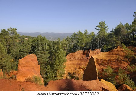 This picture was taken just as the sun was setting in Rousillon, France during late summer. It captures the red ochre, which is mined in Roussillon.