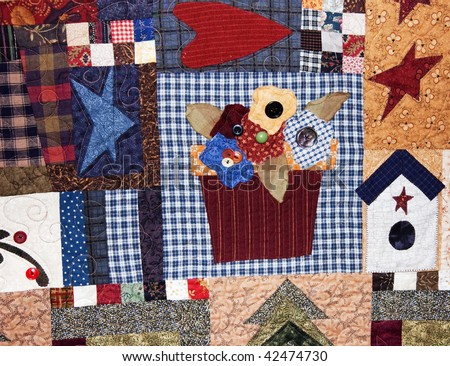 This quilt has a flower basket as it's central focus with primitive and Americana type style.
