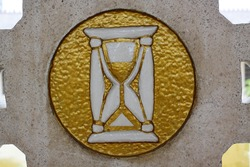 This sand clock logo brings a life meaning, founded on an old church inside a dutch's soldiers graveyard in Indonesia