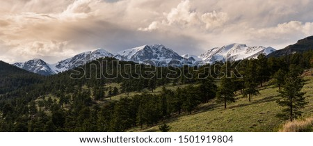 This scene depicts the turbulent skies above a scenic rocky mountain backdrop right before sunset!  Colorado and the rockies provide the ultimate adventure for any photographer. #1501919804
