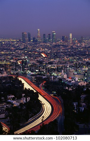 This shows the Hollywood Freeway and skyline at dusk.
