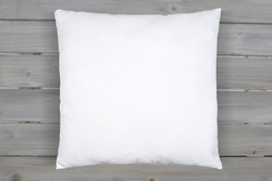 This soft white throw pillow relaxes happily on a background of rustic gray wooden planks. Plenty of room to add your own design to this square white throw pillow mock up.