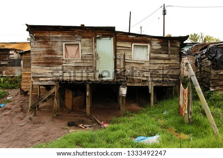 This squater township is situated on the hills east of Knysna in South Africa. Everything is wet after the rain of the previous night. #1333492247