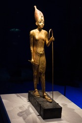 This statue is made of wood covered in gold, 1 of 32 which were in the tomb, some of which depict Tutankhamun acting out various Egyptian myths.