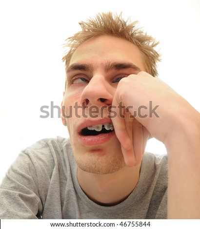 This student is bored out of his mind listening to the dull lecture that is being presented. Isolated on white background with room for your text.