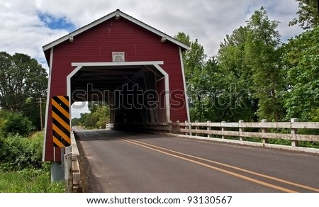 This vintage red covered bridge is a historic landmark in Linn County Oregon.  It's the Shimanek bridge over Thomas Creek built in 1966, the only red colored covered bridge in the region.