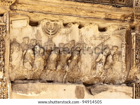 This wall relief on the Arch of Titus reveals Roman soldiers after the destruction of the Temple of Jerusalem in 70 A.D including the Temple Menorah, the Table of the Shewbread and silver trumpets.