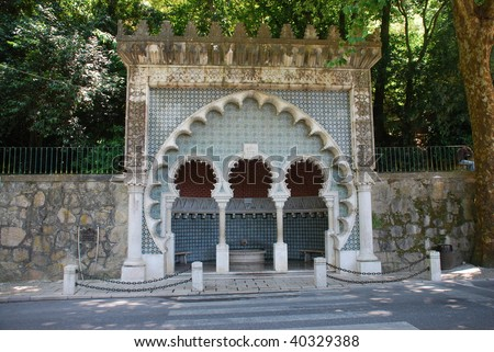 This water fountain in moorish style is located in Sintra, Portugal. It forms part of the Cultural Landscape of Sintra, recognised as an UNESCO World Heritage Site. - stock photo