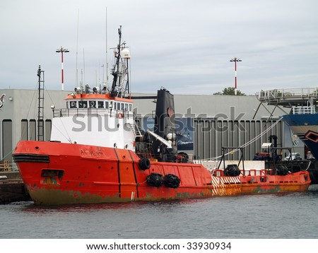 This 35 year old, 205 foot, 7200 HP Arctic Class II supply ship operates on Canada's three coasts, one of them seasonally. Built as Canmar Supplier.  Note the Inuktitut script writing on the bow.