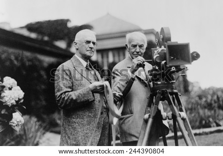 Thomas Edison 1847-1931 and George Eastman 1854-1932 standing with motion picture camera ca. 1925.