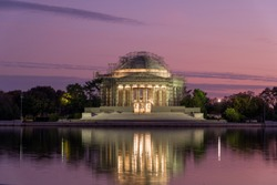 Thomas Jefferson Memorial, with scaffolding in place as a part of the Roof Restoration at Dusk, in  Washington D.C., USA