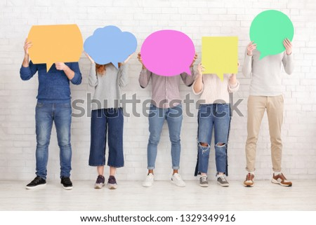 Thought bubbles. Friends holding placards with copy space over white wall