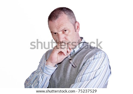 Thoughtful and pensive portrait of middle aged caucasian male