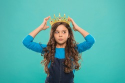 Thoughtful baby. Kid wear golden crown symbol of princess. Become princess. Lady little princess. Girl wear crown. Princess manners. Winner of beauty competition. International beauty contest.
