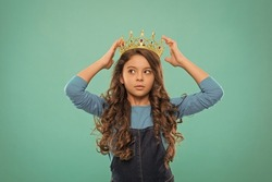 Thoughtful baby. Kid wear golden crown symbol of princess. Become princess. Lady little princess. Girl wear crown. Princess manners. Winner of beauty competition. International beauty contest
