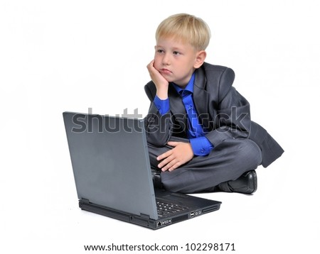 Thoughtful boy with computer, isolated on white background