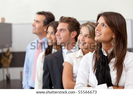 Thoughtful business team at the office smiling - stock photo