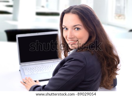 Thoughtful business woman in an office smiling.