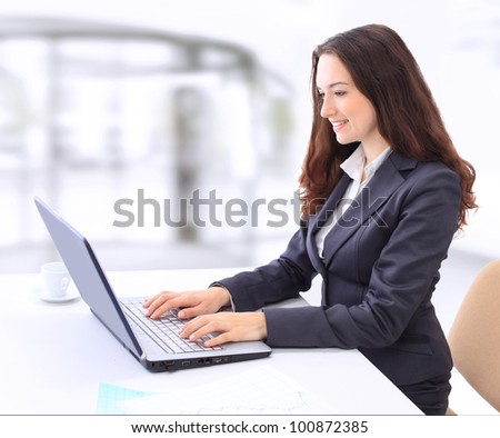 Thoughtful business woman in the office for a laptop with a smile. - stock photo