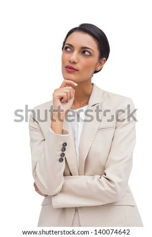 Thoughtful business woman standing on white background