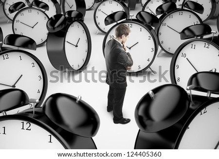 thoughtful businessman and alarm clocks