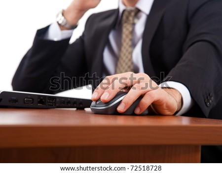 Thoughtful businessman looking at his laptop
