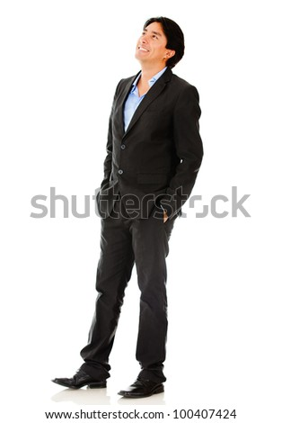 Thoughtful businessman looking up - isolated over a white background