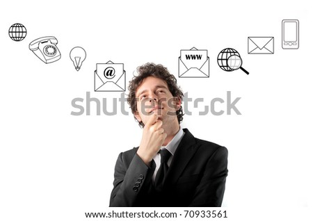 Thoughtful businessman with icons on the background