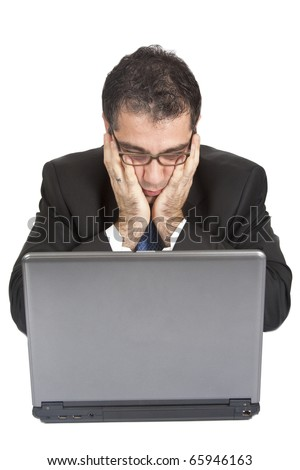 Thoughtful businessman working with laptop