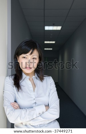 thoughtful businesswoman in a dark office corridor