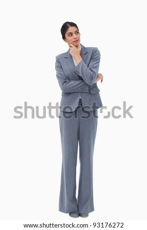 Thoughtful businesswoman looking to the side against a white background