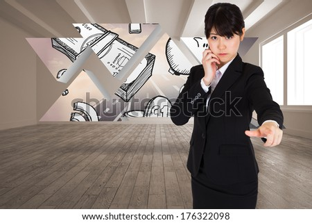 Thoughtful businesswoman pointing against profit graphic on abstract screen in room