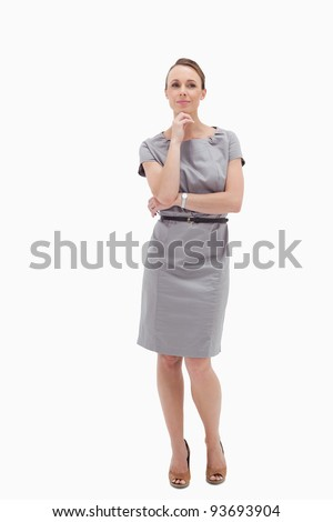 Thoughtful businesswoman posing against white background