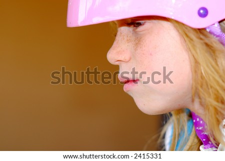 Thoughtful child with a safety helmet