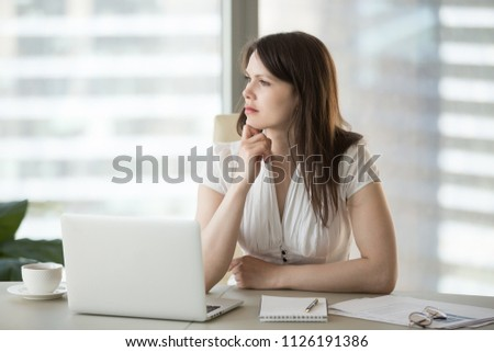 Thoughtful doubtful businesswoman looking away contemplating thinking of problem solution, serious uncertain employee unsure about difficult question deciding planning searching new ideas at work