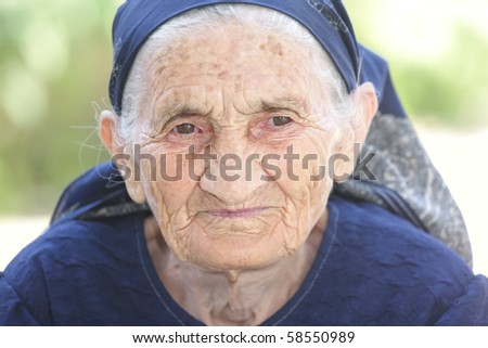 Thoughtful elderly woman outdoor closeup outdoors portrait