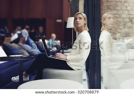 Thoughtful female person sitting in modern coffee shop interior with open laptop computer student girl doing course work on her laptop computer at the library,young businesswoman at work break working