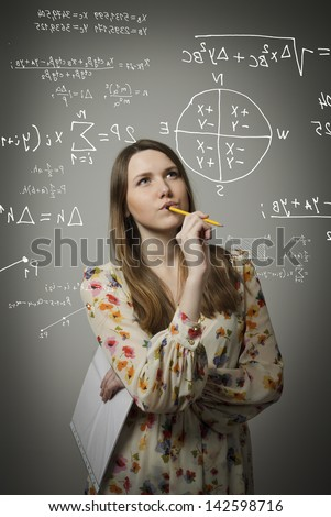 Thoughtful girl holding pen and documents and solving equation.