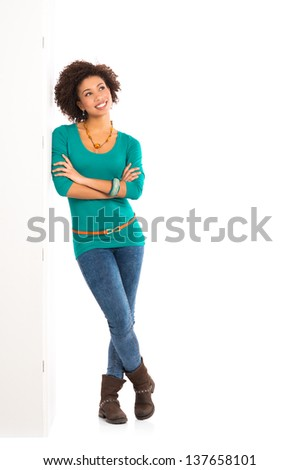 Thoughtful Girl Isolated Leaning On Wall Over White Background