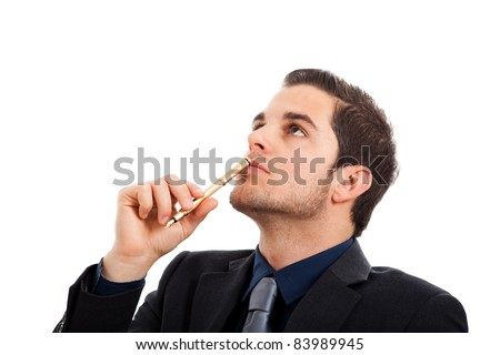 Thoughtful handsome young businessman holding a pen isolated on white