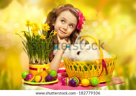 Thoughtful little girl with easter rabbit in basket and eggs. Greeting card