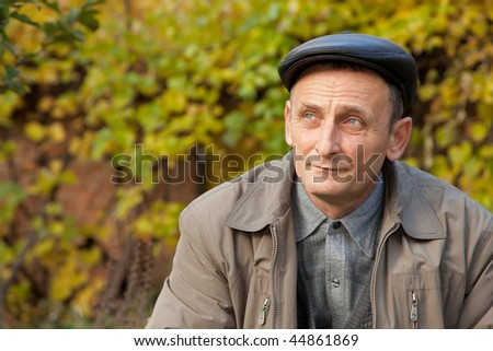 Thoughtful middle-aged man in autumnal garden