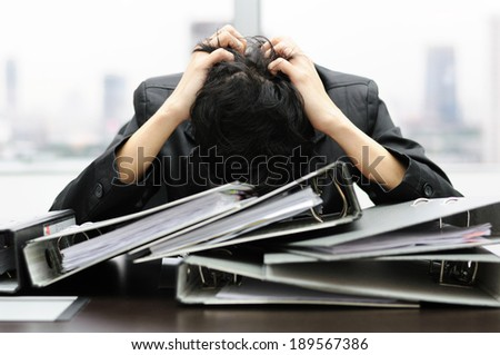 Thoughtful or stressful businessman at work